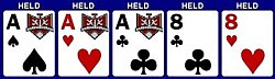 As, Ah, Ac, 8c, 8h. Hold all five cards